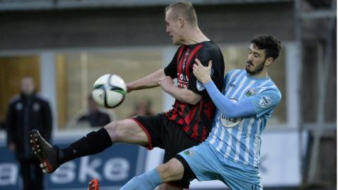 Jordan Owens of Crusaders and Jordan Dane of Warrenpoint in action during the Premiership game at Milltown