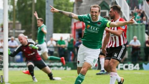Karl Sheppard runs away in celebration after scoring the first of his two goals against Derry