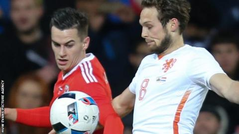 Tom Lawrence (left) takes on Daley Blind during Wales' 3-2 friendly loss to Netherlands in November 2015