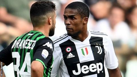 11a0ee89d4a Douglas Costa  Juventus winger banned for four games for spitting ...