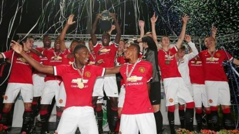Manchester United celebrate winning the Premier Section title at the tournament in 2014