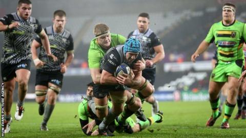 Justin Tipuric is hauled down by desperate Northampton defenders