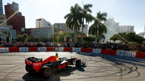 A Red Bull F1 car does donuts at an exhibition in Miami