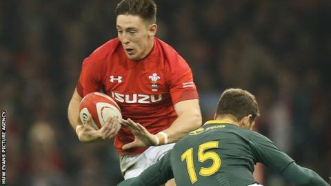 Wales' Josh Adams takes on South Africa's Willie Le Roux