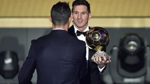 Cristiano Ronaldo shakes hands with Lionel Messi