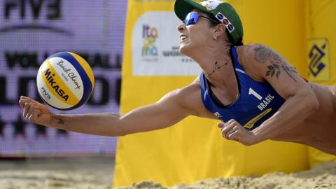 ITAPEMA, BRAZIL - MAY 19: Agatha Bednarczuk of Brazil in action during the main draw - Quarterfinals match against Victoria Bieneck and Isabel Schneider of Germany at Meia Praia Beach during day one of the FIVB Beach Volleyball World Tour Itapema on May 19, 2018 in Itapema, Brazil. (Photo by Alexandre Loureiro/Getty Images)