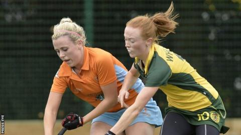 Becky Weir of Ards battles with Railway Union's Anna May Whelan