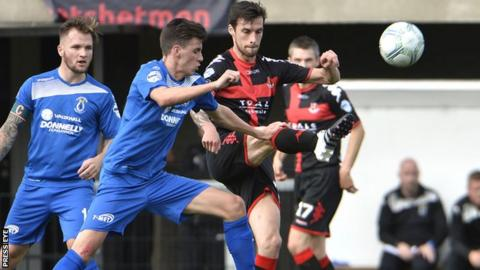 Jamie Glackin challenges Declan Caddell for possession at Seaview