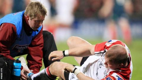 Gareth Robinson treats Callum Black during an Ulster game in 2014