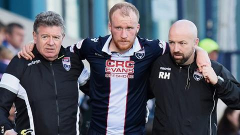 Ross County's Liam Boyce is helped off against St Johnstone