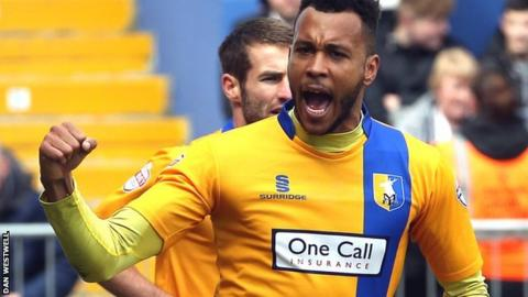 Matt Green celebrates a goal for Mansfield