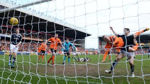 Billy Mckay scores for Dundee United against Dundee