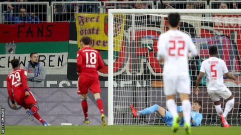 Kingsley Coman celebrates scoring in Bayern Munich's 3-2 victory over Augsburg in the Bundesliga