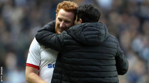Dean Lewington (left) shares an embrace with new MK Dons boss Dan Micciche