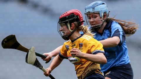 Isabella O'Hare of Clonduff in action against Shauna Fitzgerald of St Martin's