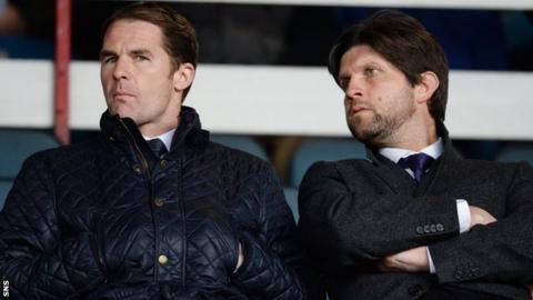 Alan Archibald (left) and his assistant Scott Paterson watch the Dundee v Dundee United match on Monday
