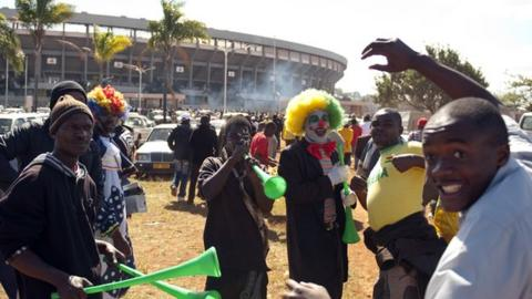 Fans outside the National Sport Stadium in Harare