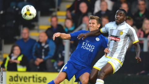Kelvin Maynard (right) in action against Leicester City's Dean Hammond