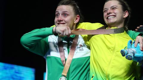 Silver medallist Michaela Walsh of Northern Ireland and gold medallist Skye Nicolson of Australia during the medal ceremony for the women's 57kg boxing final on day 10 of the Gold Coast 2018 Commonwealth Games at Oxenford Studios