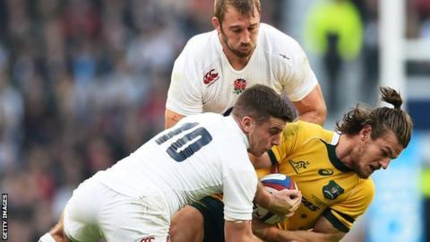 Rob Horne of Australia is tackled by George Ford and Chris Robshaw of England