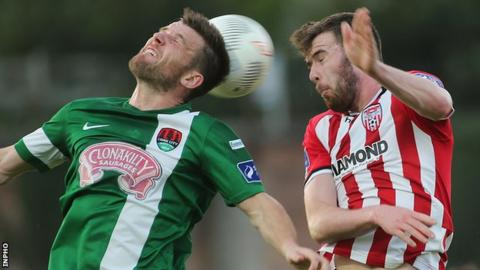 Steven Beattie and Patrick McClean in aerial action at the Brandywell