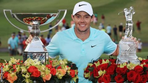 Rory McIlroy with the Tour Championship and FedEx Cup trophies
