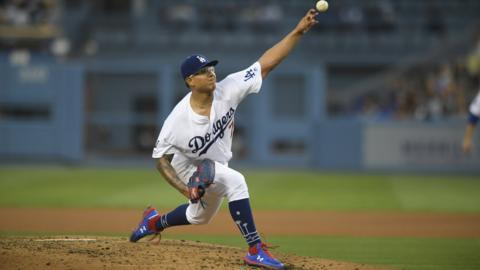LOS ANGELES, CA - JUNE 20: Julio Urias #7 of the Los Angeles Dodgers pitches against the San Francisco Giants in the third inning at Dodger Stadium on June 20, 2019 in Los Angeles, California. The Dodgers won 9-8. (Photo by John McCoy/Getty Images)