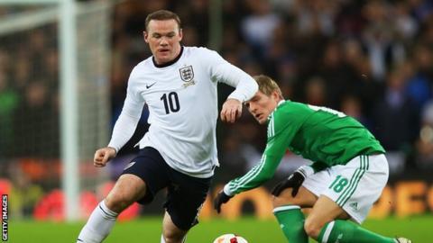 England striker Wayne Rooney (left) and Germany's Toni Kroos