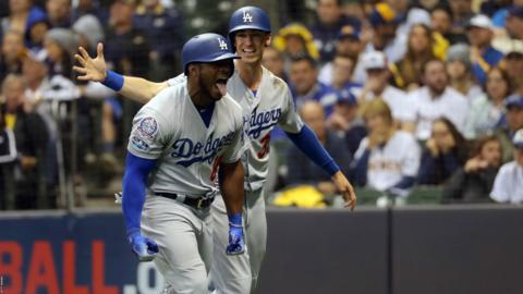 Los Angeles Dodgers' Yasiel Puig and Cody Bellinger