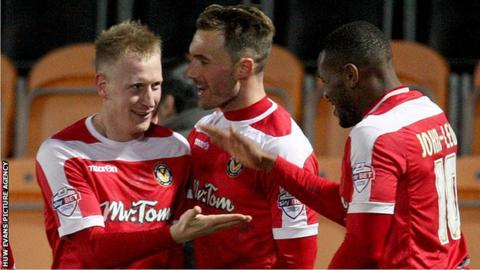 Newport celebrate their goal against Barnet