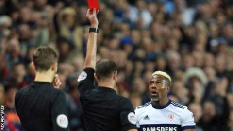 Middlesbrough's Adama Traore shown a red card early on against Aston Villa
