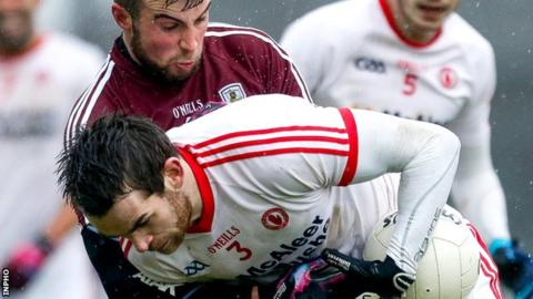 Galway's Paul Conroy puts in a challenge on Tyrone defender Ronan McNamee at Salthill