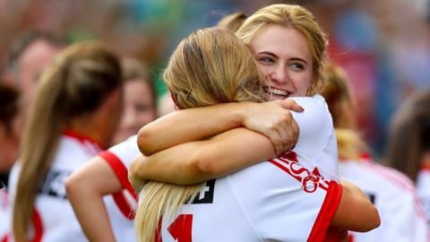 Emma Mulgrew celebrates after the game with Lycrecia Quinn
