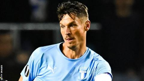 Markus Rosenberg played a captain's part for Malmo as he notched a hat-trick