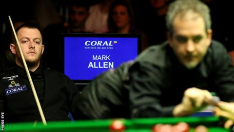 Mark Allen can only watch on as Anthony Hamilton plays a shot