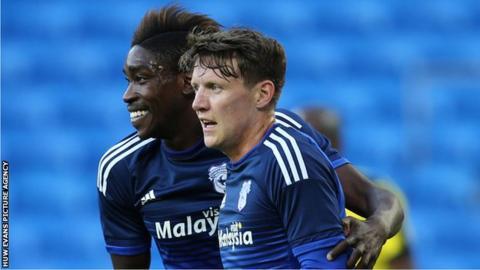 Joe Mason and Sammy Ameobi celebrate after Cardiff City take the lead against Watford