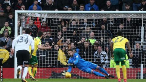 Derby County goalkeeper Scott Carson saves Nelson Oliveira's first-half penalty