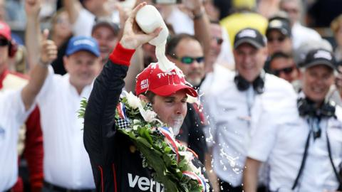 INDIANAPOLIS, IN - MAY 27: Will Power of Australia, driver of the #12 Verizon Team Penske Chevrolet celebrates by drinking milk after winning the 102nd Running of the Indianapolis 500 at Indianapolis Motorspeedway on May 27, 2018 in Indianapolis, Indiana. (Photo by Chris Graythen/Getty Images)