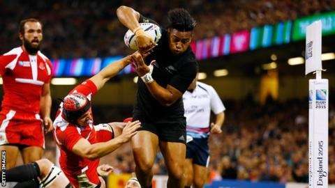 Julian Savea drives over the line to score for New Zealand