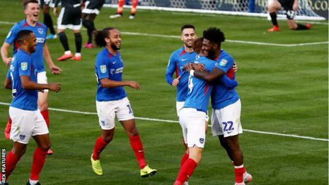 Ellis Harrison celebrates his goal for Portsmouth against Birmingham City