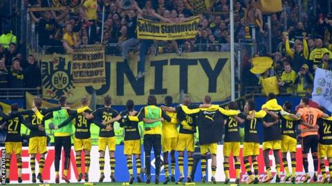 Dortmund players celebrate in front of their fans