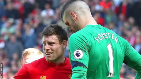 Liverpool's James Milner (left) and Fraser Forster