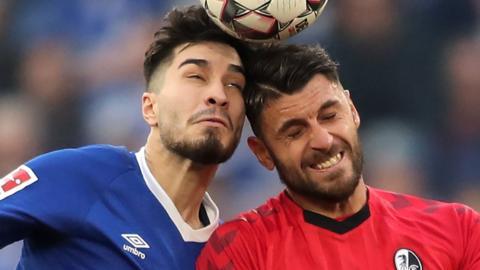 Suat Serdar of Schalke challenges Freiburg's Vicenzo Grifo