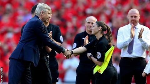 Sian Massey-Ellis shakes Arsene Wenger's hand