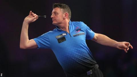 Justin Pipe throws a dart during victory over Bernie Smith at the PDC World Championship