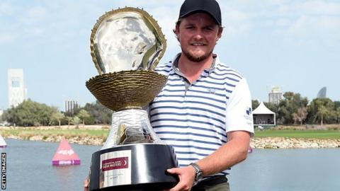 Eddie Pepperell celebrates winning the Qatar Masters