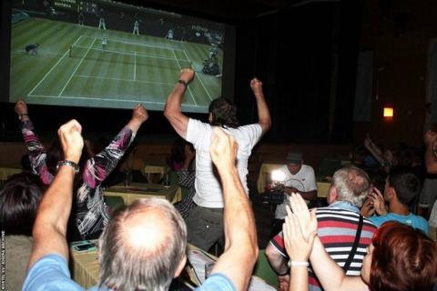 Fans in Fulnek watch Kvitova beat Eugenie Bouchard 6-3 6-0 in the 2014 Wimbledon final