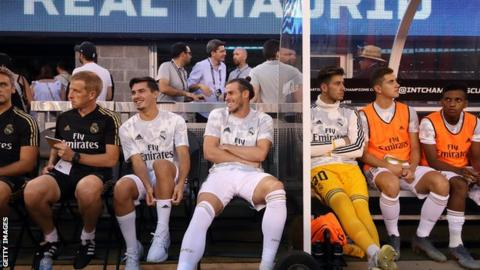 Gareth Bale laughs on the bench
