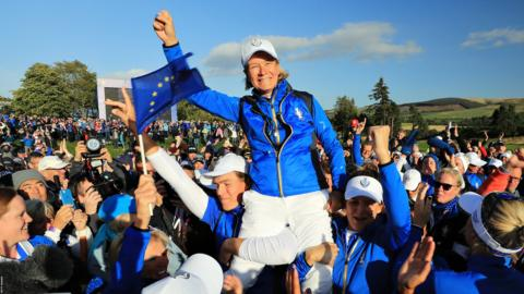 Auchterarder, Scotland, September 15: Team Europe captain Catriona Matthew is hoisted onto her players' shoulders to celebrate her teams win during the final day singles matches of the Solheim Cup at Gleneagles (Photo by David Cannon/Getty Images).