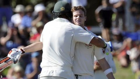 Joe Burns and Steve Smith celebrate